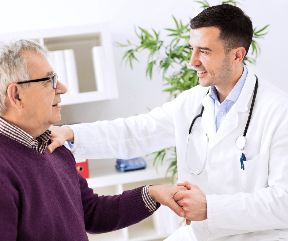 Doctor talking with an elderly male patient