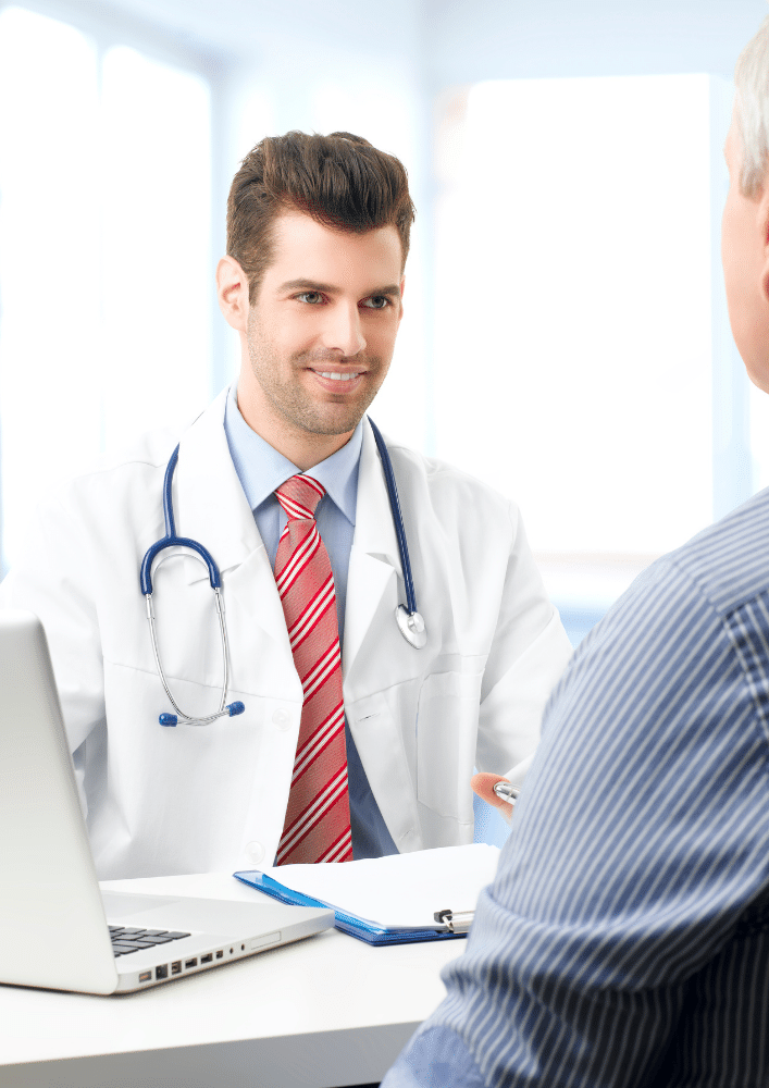 Young male doctor speaking with patient