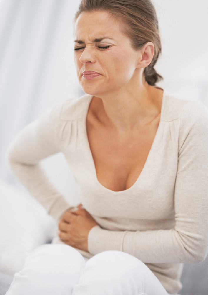 Young woman in pain suffering from pelvic congestion syndrome